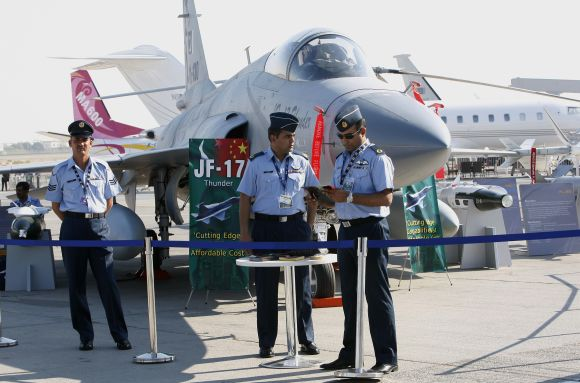 Pakistani pilots stand in front of the JF-17 Thunder fighter plane during the second day of the Dubai Airshow